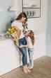 Leinwandbild Motiv  little girl gives flowers to mother on March 8
