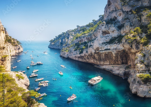 Yachts at the sea in France. Aerial view of luxury floating boat on transparent turquoise water at sunny day. Summer seascape from air. Top view from drone. Travel concept and idea © Biletskiy Evgeniy