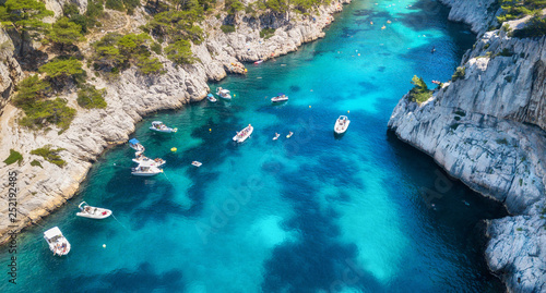 Yachts in sea bay in France. Aerial view of luxury floating boat on transparent turquoise water at sunny day. Summer seascape from air. Top view from drone. Travel concept and idea © Biletskiy Evgeniy