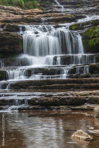 obraz lub plakat Waterfall in long exposure in Cantabria. Spain