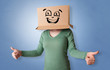 Leinwanddruck Bild - Young woman with happy face illustrated cardboard box on her head