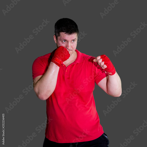 White male boxer in Boxing stand during training isolated on grey background 10