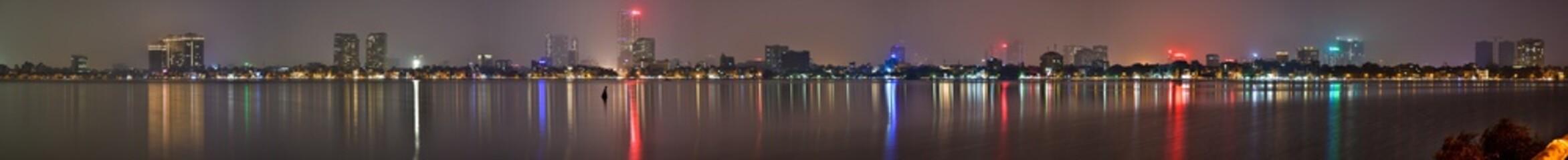 Hanoi skyline at night from West Lake.