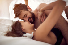 "Постер, картина, фотообои ""couple lovers making love in bed- Passionate sex."""