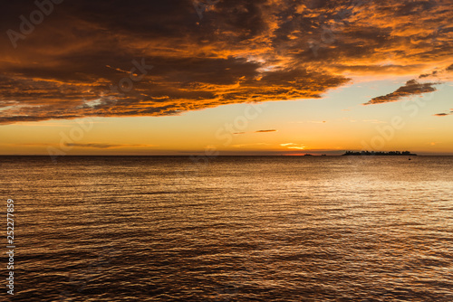 Landscape nature of beautiful sunset sky at the beach and colorful shiny sea ocean on a sunny day - 252277859