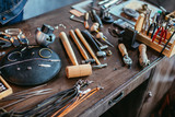 desk with a collection of jewelry tools for complete specific jewelry projects.