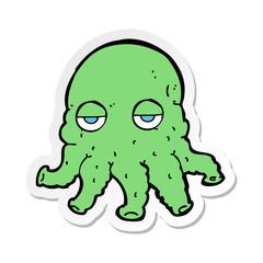 sticker of a cartoon alien squid face