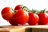 ripe cherry tomato branch on a board