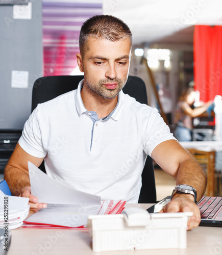 Portrait successful Businessman entrepreneur working at busy office