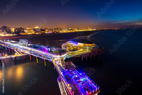 Aerial view on the illuminated pier at Scheveningen, the Hague at night. © Sander Meertins