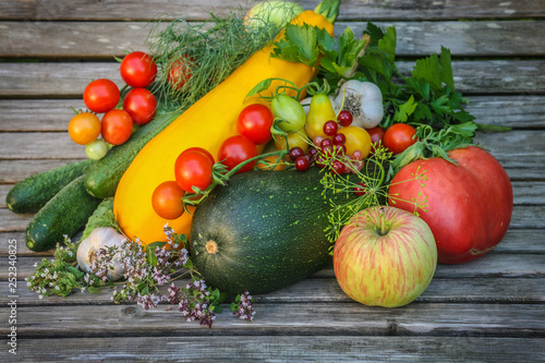 vegetables and fruits on a background boards - 252340825