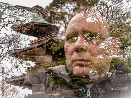 Double exposure of traveller and five story pagoda © imagesbykenny