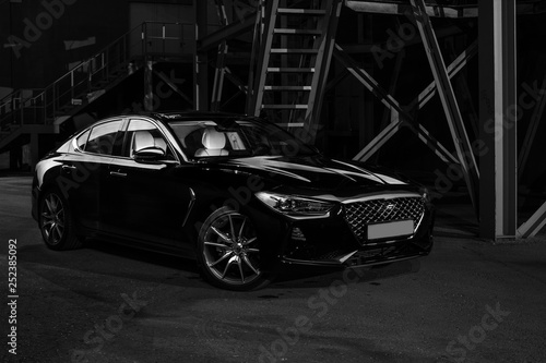 Four-door sport coupe. Silhouette of black sports car with headlights - 252385092