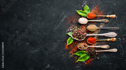 Colored pepper and sea salt. Top view. On the old background. free space for your text. - 252388041