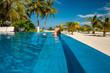 Woman at beach pool in Maldives