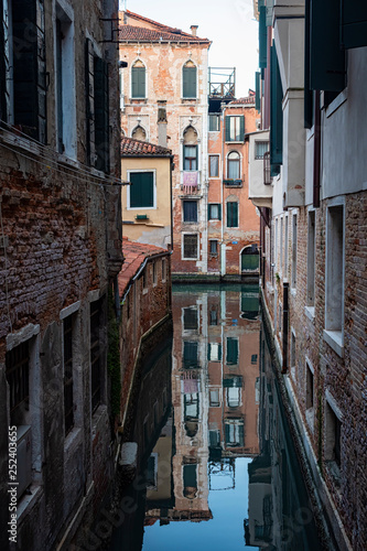 Typical canal of Venice - 252403655