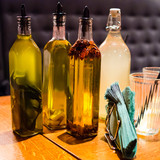 Olive oils and lemoniade on wooden tabale