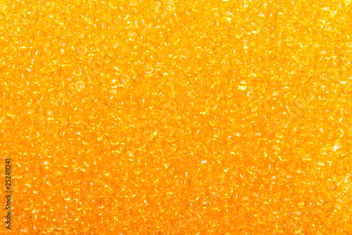 Background of yellow amber beads.Texture of yellow beads. - 252411241