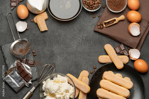 Frame made of Ingredients for traditional tiramisu cake on concrete background - 252427698