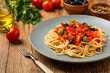 Leinwanddruck Bild - Italian spaghetti alla Pultanesca with tomatoes and olives. Served without meat and cheese.