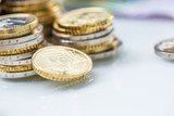 Towers with euro coins stacked together - close-up