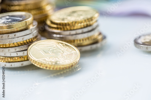 Leinwanddruck Bild Towers with euro coins stacked together - close-up