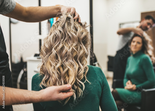 Leinwanddruck Bild Beautiful hairstyle of mature woman after dying hair and making highlights in hair salon.