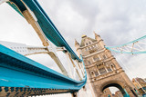 Close up detail of one of the blue supports and tower of Tower Bridge, London England. Travel and architecture concept.