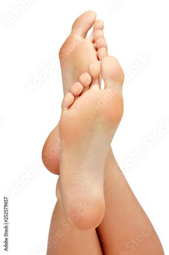 Closeup shot of female feet isolated on white background.