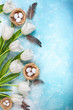 Easter composition with Easter eggs in nest and white tulips - 252583621