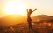 Leinwanddruck Bild - Happy woman jumping and enjoying life  at sunset in mountains.
