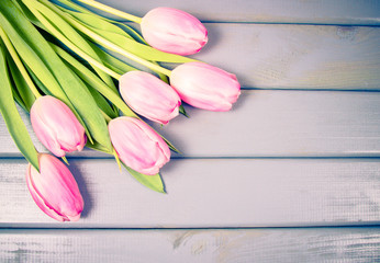 A bouquet of pink tulips with a frame for inscription.