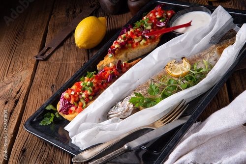 the perfectly baked oven trout with lemon and herbs - 252611804