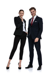 couple in business suits holding hands at chin thinking