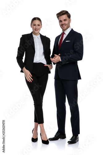 couple in business suits standing with hands together © Viorel Sima