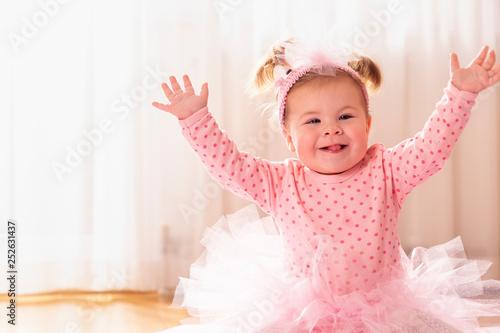 Playful baby girl smiling