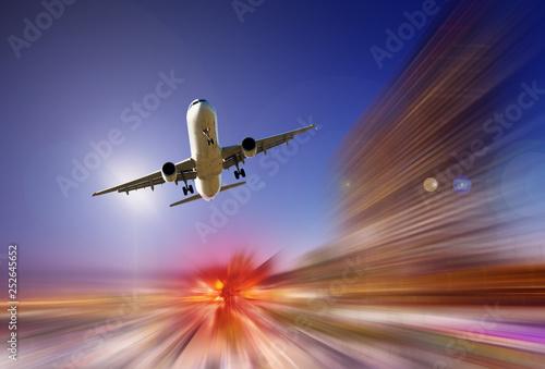 Leinwandbild Motiv Big airplane in sky on blurred background