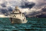 Warship on sea of dramatic scenery.