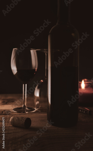 Romantic ambiance wine bottle and wine glasses with candle light © florin