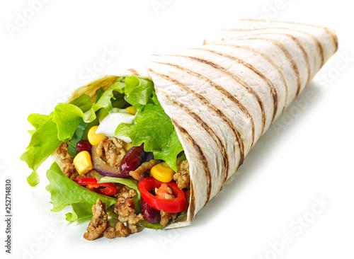 Leinwandbild Motiv Tortilla wrap with fried minced meat and vegetables