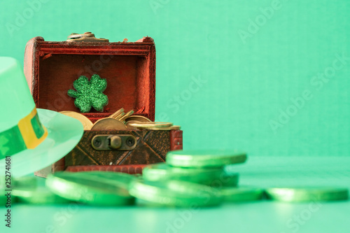 Green hat with Clover and green coins - St Partrick 's Day concept