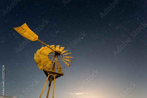 An iconic Australian windmill with a night sky in the background.