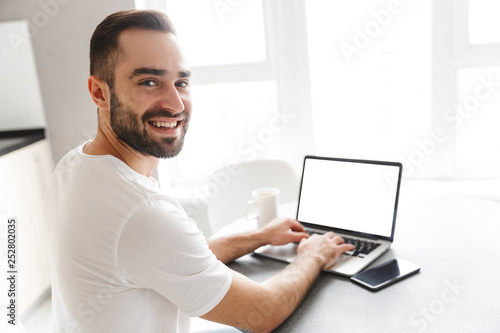 Happy handsome man freelancer
