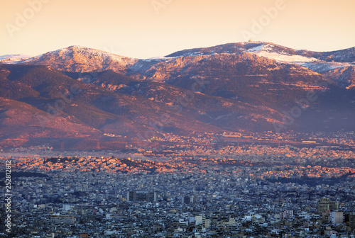 Leinwanddruck Bild City and acropolis from Lycabettus hill in Athens at sunrise, Greece