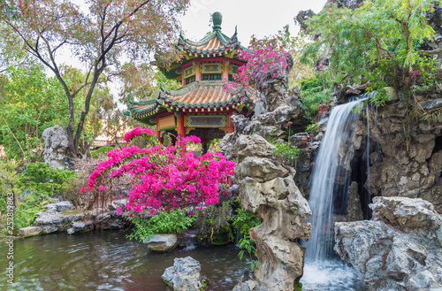 pavilion and waterfall in oriental garden in Hong Kong, China © leeyiutung