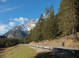 Fototapeta Natura - Dolomites nature. Road and mountains. Clear blue sky © Barselona Dreams