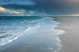 North sea beach at cloudy rainy weather