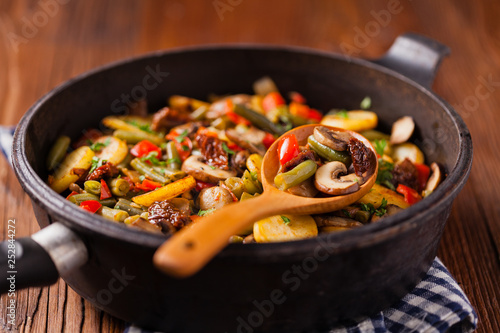 Fried pan vegetables, with mushrooms and dried tomatoes. Seasoned with a mix of herbs. - 252844272