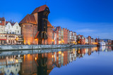 Fototapeta Miasto - Beautiful old town of Gdansk with historic Crane at Motlawa river, Poland © Patryk Kosmider