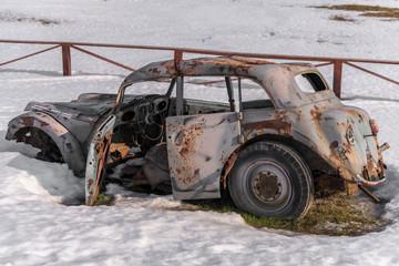 Old rusty car wreck